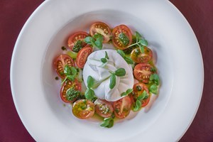 Tomatoes and Burrata available on the lunch and dinner menus at Balthazar in Covent Garden