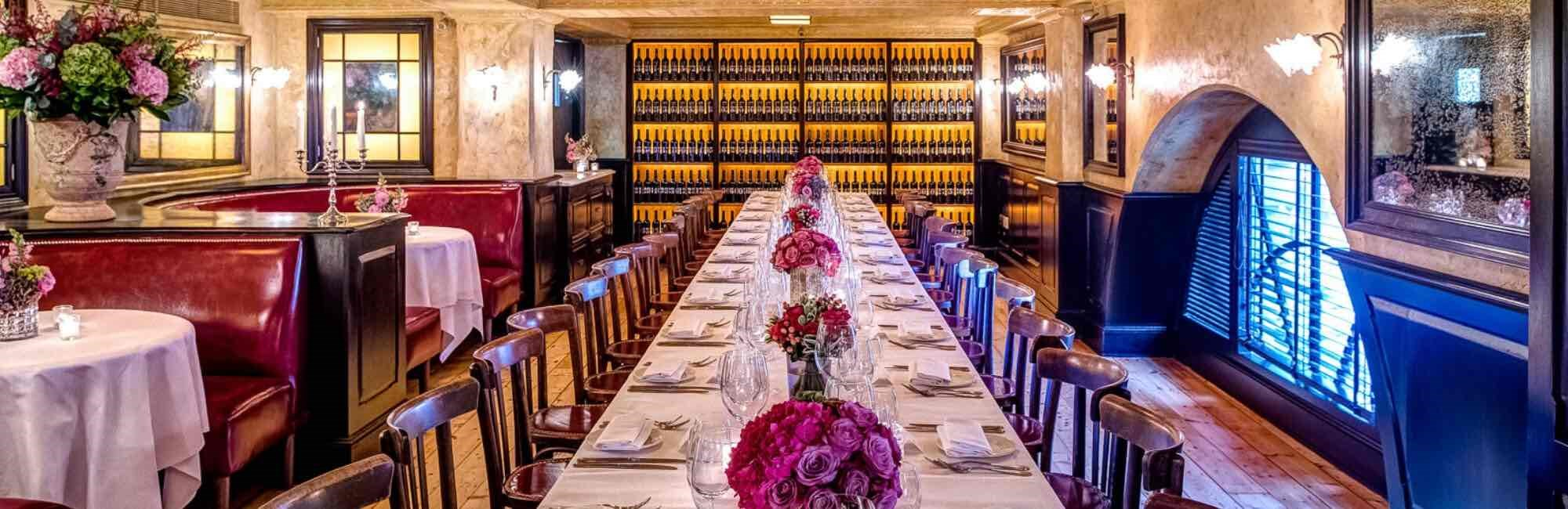 Long table set for large private dining party in Le Grand Salon